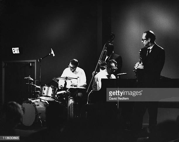 American jazz pianist and composer Dave Brubeck performs with his quartet, from left, drummer Joe Morello, bassist Eugene Wright and saxophonist Paul...