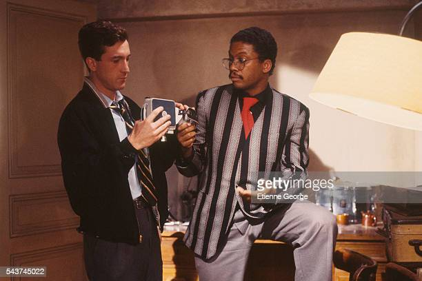 American jazz pianist and composer Herbie Hancock with French actor François Cluzet on the set of 'Round Midnight' based on the David Rayfiel...