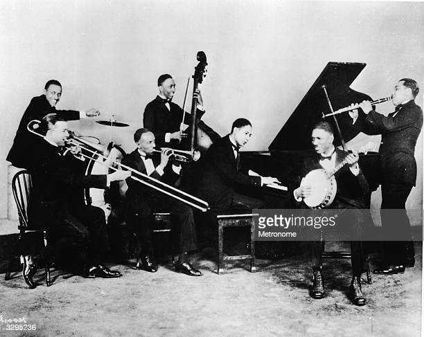 American jazz pianist and composer 'Jelly Roll' Morton plays piano with his band The Red Hot Peppers, circa 1926. The band featured trombonist Kid...