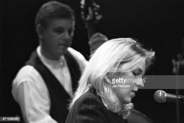 American jazz pianist and singer Diana Krall performing at Copenhagen Denmark Jazz House 1996 In the background bass player Paul Keller