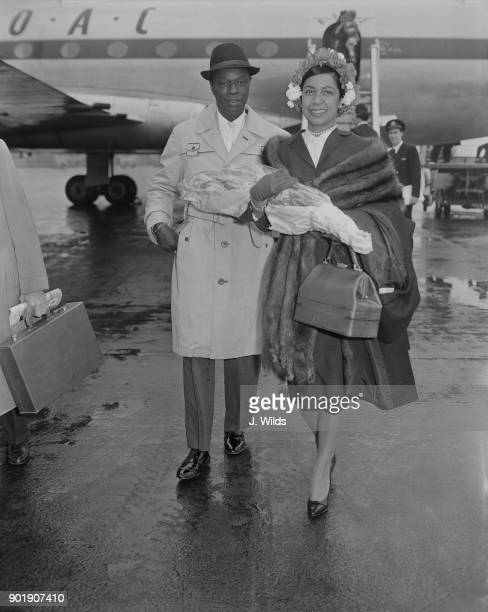 American jazz pianist and singer Nat King Cole arrives at London Airport with his wife Maria 12th May 1960 He will be topping the bill at Val...