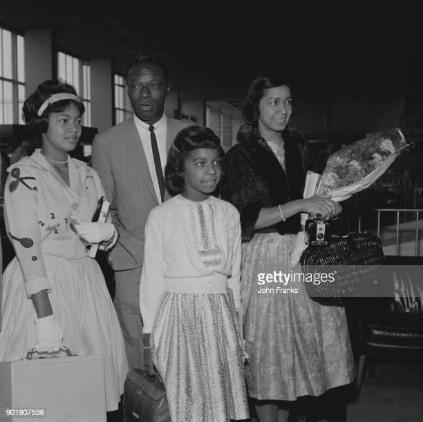 American jazz pianist and singer Nat King Cole at London Airport with his wife Maria and their daughters Natalie and Carole 3rd August 1960 The...