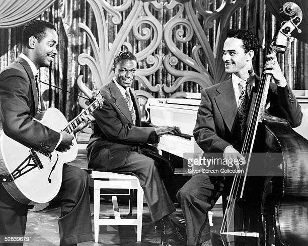 American jazz pianist and singer Nat King Cole performing with the 'Nat 'King' Cole Trio' circa 1949 With him are guitarist Irving Ashby and bassist...