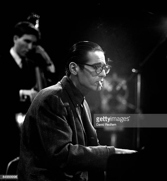 American jazz pianist Bill Evans at the piano during a performance by the Bill Evans trio filmed for the BBC Television music series 'Jazz 625' at...