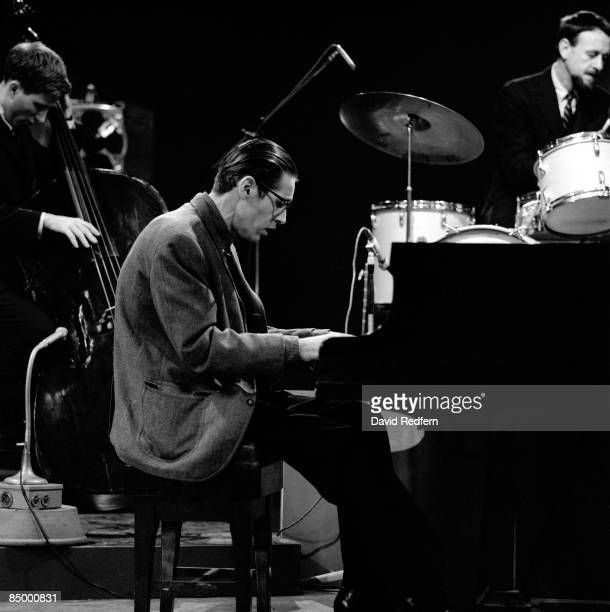 American jazz pianist Bill Evans at the piano during a performance by the Bill Evans trio, featuring Larry Bunker on drums and Chuck Israels on bass,...