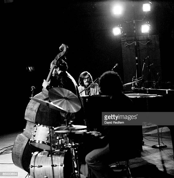 Photo of Eddie GOMEZ and Bill EVANS and Bill EVANS and Marty MORELL performing live onstage LR Eddie Gomez Bill Evans Marty Morell