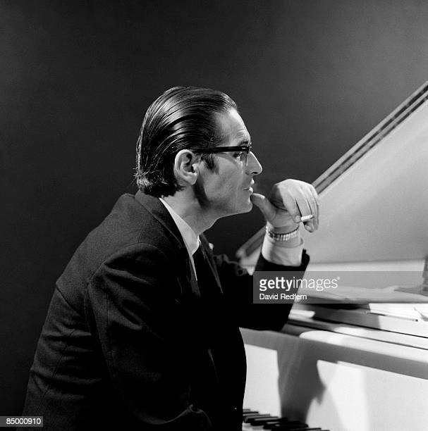 American jazz pianist Bill Evans seated at the piano on set during a performance by the Bill Evans trio filmed for the BBC Television music series...