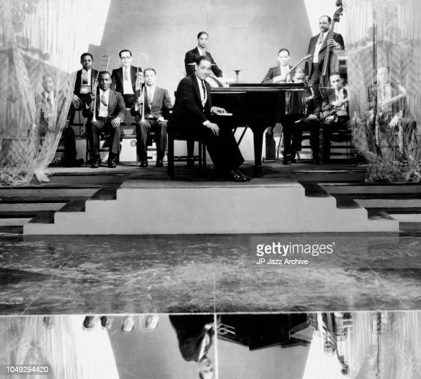 American jazz pianist composer and bandleader Duke Ellington Orchestra 1929. Behind from left Tricky Joe Nanton, Juan Tizol Sonny Greer Fred Cray...