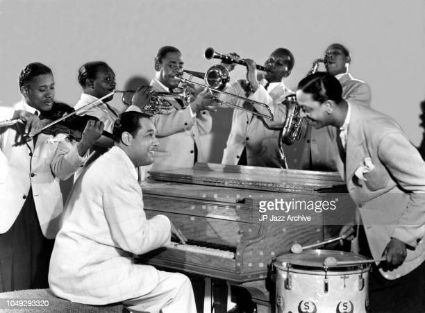 American jazz pianist composer and bandleader Duke Ellington with from left Ray Nance, Rex Steward, Tricky Sam Nanton, Harry Carney, Johnny Hodges...