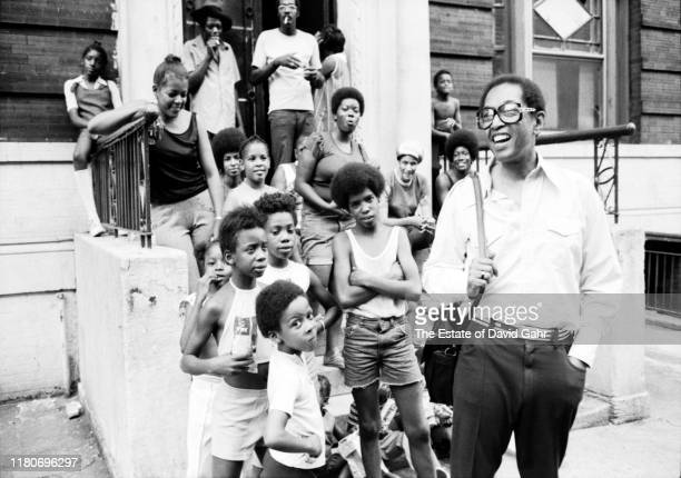 American jazz pianist composer broadcaster and educator Billy Taylor poses for a portrait with friends and neighbors during a jazz performance on the...