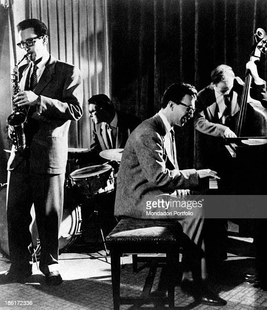 American jazz pianist Dave Brubeck born David Warren Brubeck plays onstage with his quartet including Paul Desmond at alto saxophone The 50's