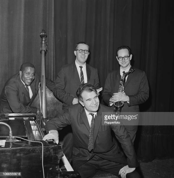 American jazz pianist Dave Brubeck pictured seated at the piano with fellow musicians, from left, bassist Eugene Wright, drummer Joe Morello and...