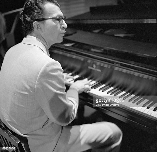 American jazz pianist Dave Brubeck plays the piano during a performance on 'The Ed Sullivan Show' New York New York October 16 1955