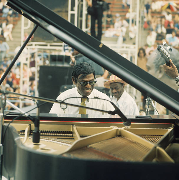 Pianist Earl Hines performs on stage as part of the...