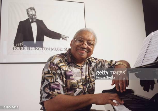 American jazz pianist Ellis Marsalis in New York City 1995 Behind him is a poster of Duke Ellington