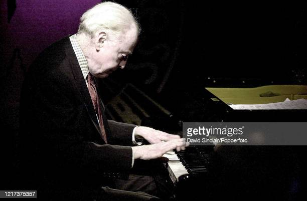 American jazz pianist John Bunch performs live on stage at PizzaExpress Jazz Club in Soho London on 19th December 2001
