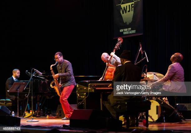 American Jazz pianists Jason Moran and Robert Glasper lead a band at the Blue Note Records 75th Anniversary Concert during the 2014 NYC Winter...