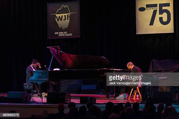 American Jazz pianists Robert Glasper and Jason Moran play dual pianos at the Blue Note Records 75th Anniversary Concert during the 2014 NYC Winter...