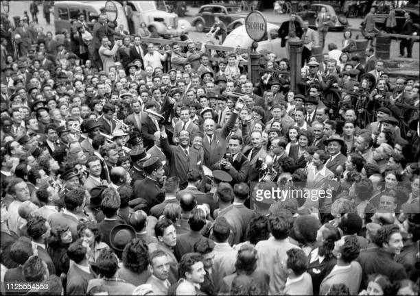American jazz piannist and composer Duke Ellington with Kay Francis and Jules Borkon are cheered by the crowd upon their arrival in Paris 19 July 1948