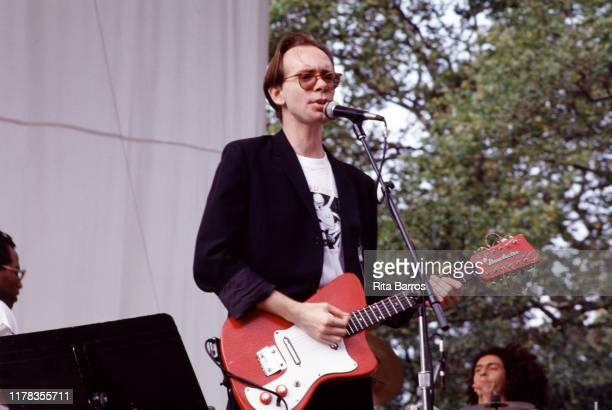American Jazz, Rock, and experimental musician Arto Lindsay plays guitar as he performs onstage in Central Park, New York, New York, July 1991.