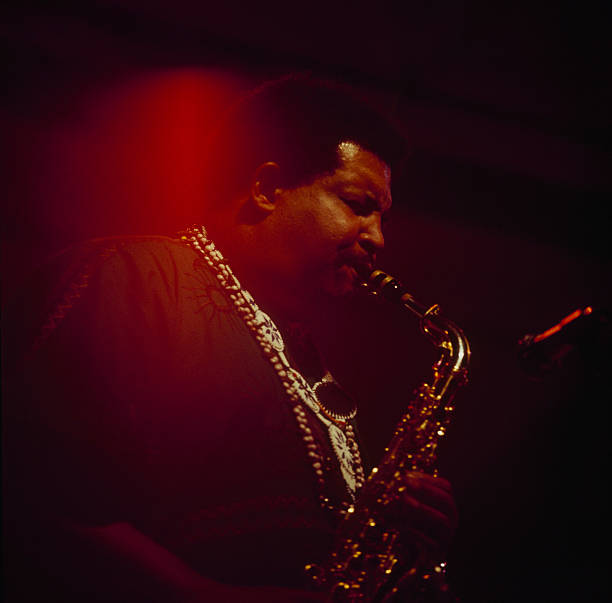 Saxophonist Cannonball Adderley performs on stage at...