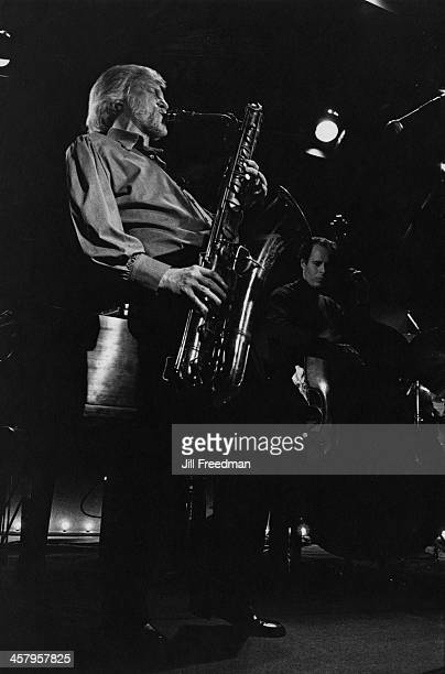 American jazz saxophonist clarinetist composer and arranger Gerry Mulligan and double bassist Frank Luther perform at at 'Kenny's Castaways' New York...