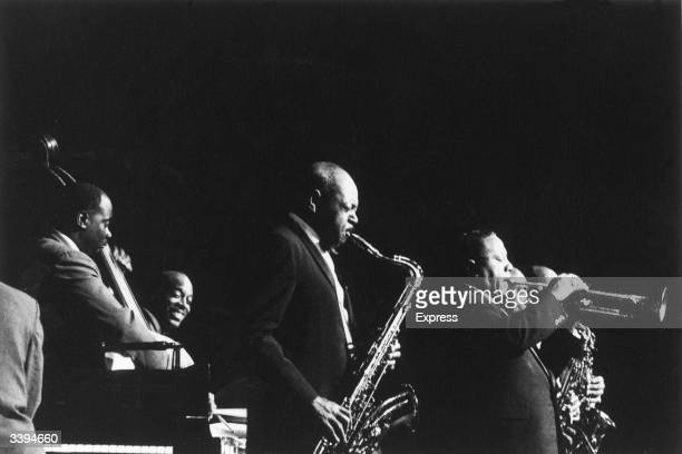 American jazz saxophonist Coleman Hawkins and jazz trumpeter Dizzy Gillespie in concert with the Cannonball Adderley Quintet, 27th November 1960.