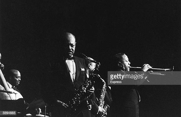 American jazz saxophonist Coleman Hawkins in concert with trumpeter Dizzy Gillespie , 27th November 1960.