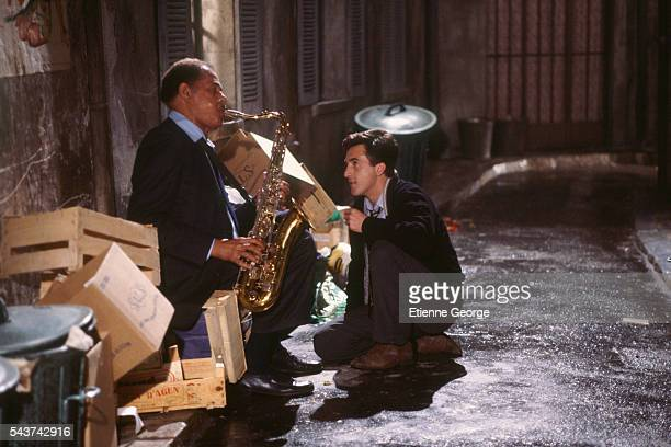 American jazz saxophonist Dexter Gordon and French actor François Cluzet on the set of 'Round Midnight' based on the David Rayfiel screenplay...