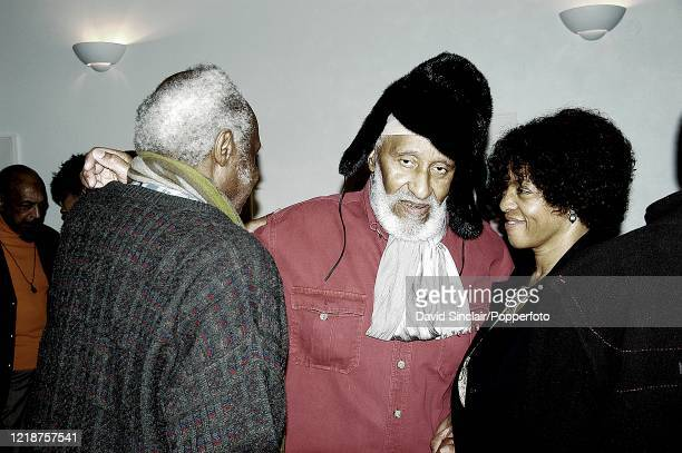 American jazz saxophonist Sonny Rollins posed in centre with publisher Margaret Busby and double bassist Henry Grimes backstage at The Barbican in...