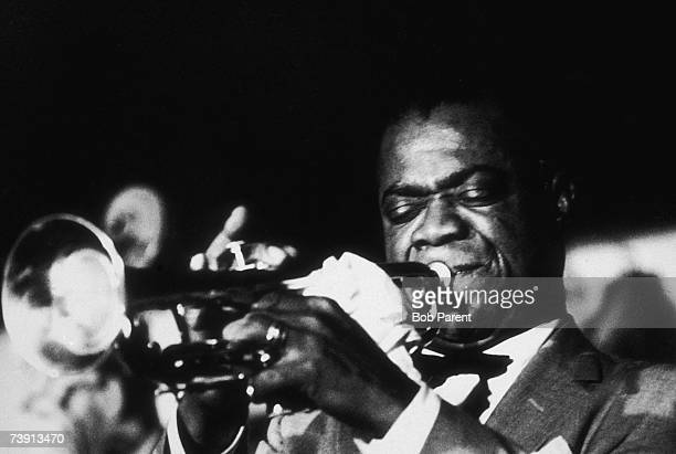 American jazz singer and trumpeter Louis Armstrong in concert at the Basin Street Cafe, New York City, 27th June 1956.