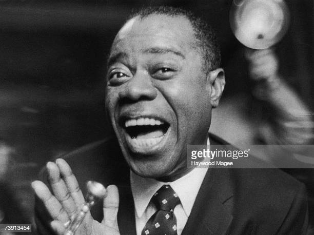 American jazz singer and trumpeter Louis Armstrong on tour in the UK 19th May 1956 Original Publication Picture Post 8393 Satchmo Blows In pub 1956