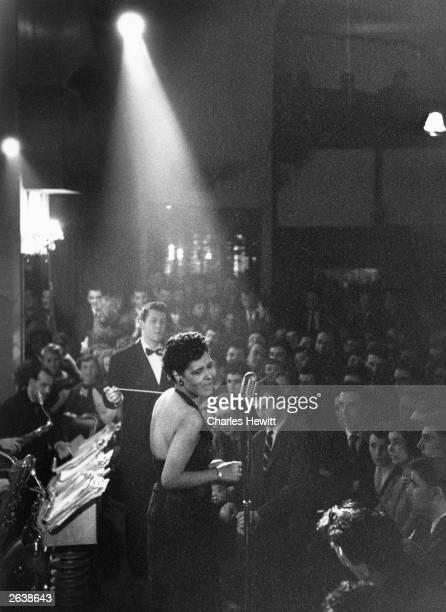 American jazz singer Billie Holiday in the spotlight during a performance Original Publication Picture Post 7380 Billie Holiday unpub