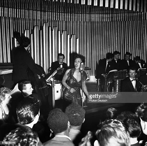 American jazz singer Billie Holliday performing on stage