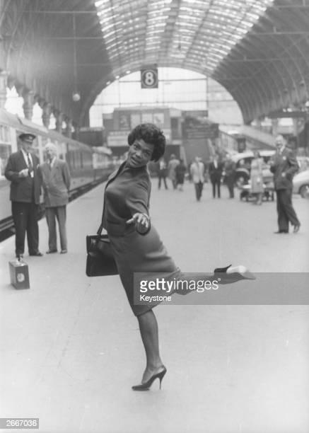 American jazz singer Eartha Kitt at Paddington Railway station before the start of a two month cabaret tour