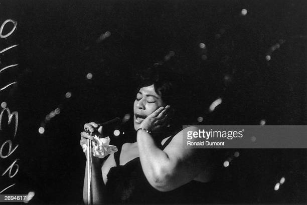 American jazz singer Ella Fitzgerald singing at the Hammersmith Odeon