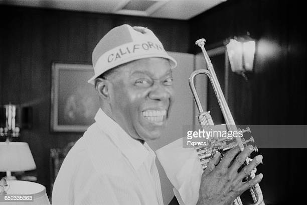 American jazz singer musician Louis Armstrong in a New York office wearing a 'California' hat June 1971