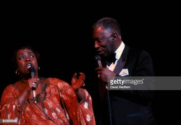 American jazz singers Sarah Vaughan and Joe Williams perform live on stage together during a concert circa 1980.
