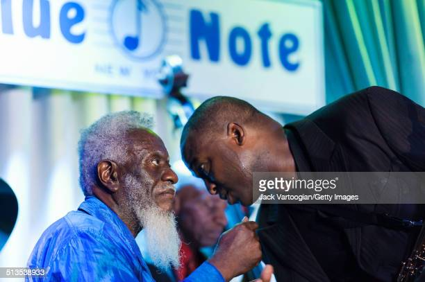 American Jazz tenor saxophonists Pharoah Sanders and James Carter confer during a performance with the Odean Pope Sextet at The Blue Note New York...