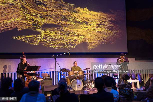 American Jazz trio 1032K perform onstage during at the David Rubenstein Atrium at Lincoln Center New York New York February 26 2015 Pictured are from...