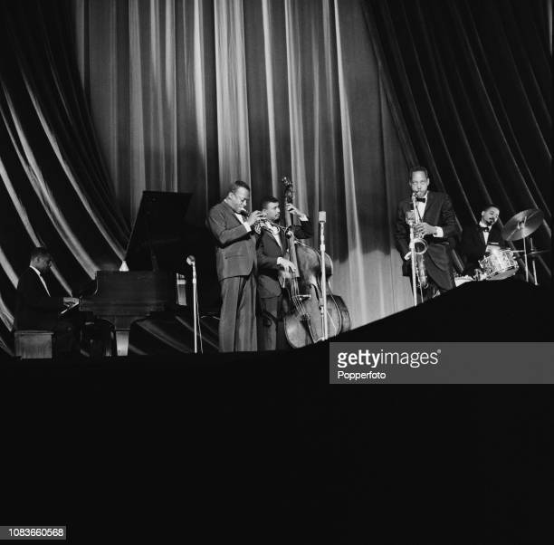 American jazz trumpet player Miles Davis performs live on stage with the Miles Davis Quintet featuring drummer Jimmy Cobb saxophonist Sonny Stitt...
