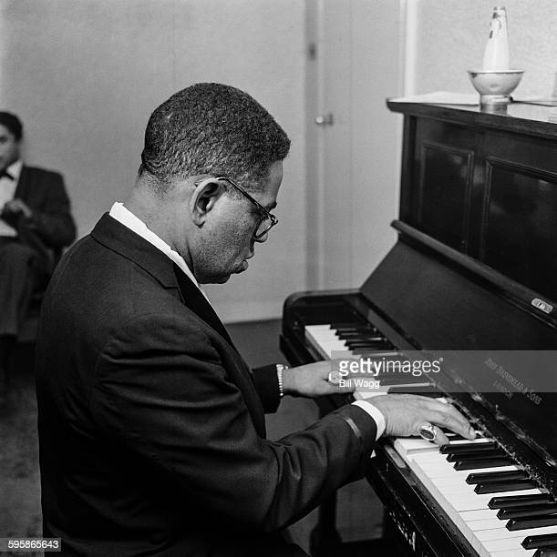 American jazz trumpeter and bandleader Dizzy Gillespie at the piano circa 1960