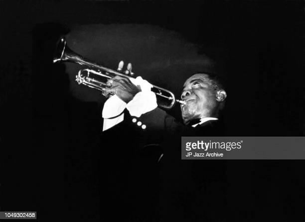 American jazz trumpeter and bandleader Louis Armstrong performing, Copenhagen, Denmark, 1956.