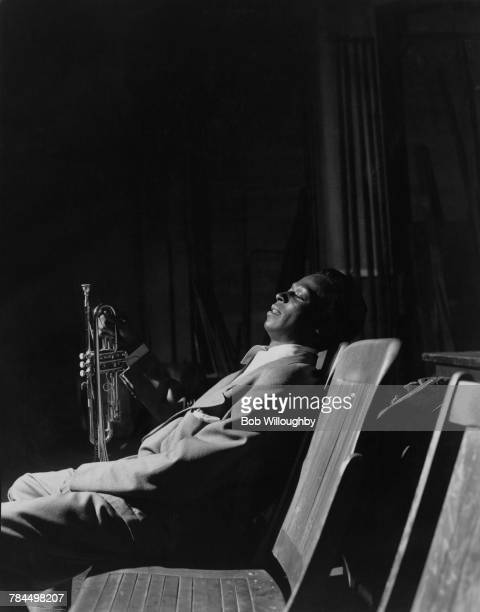 American jazz trumpeter and composer Miles Davis backstage at promoter Gene Norman's 'Just Jazz' Concert, at the Shrine Auditorium, Los Angeles,...