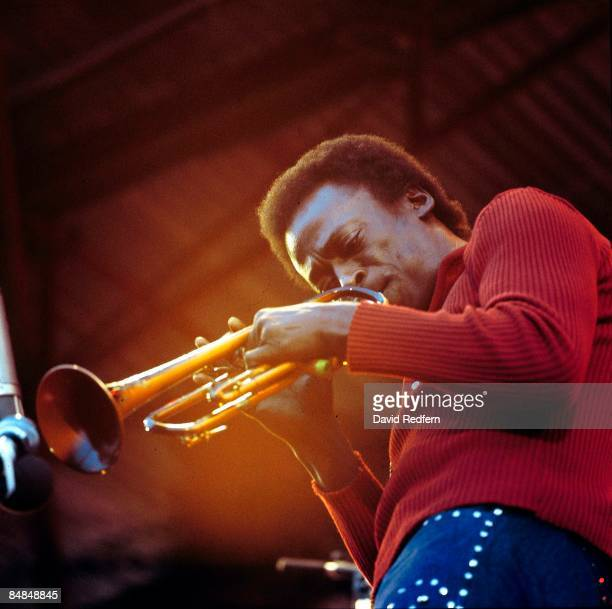 American jazz trumpeter and composer Miles Davis performs live on stage at the Isle Of Wight Festival 1970 at Afton Down on the Isle of Wight England...