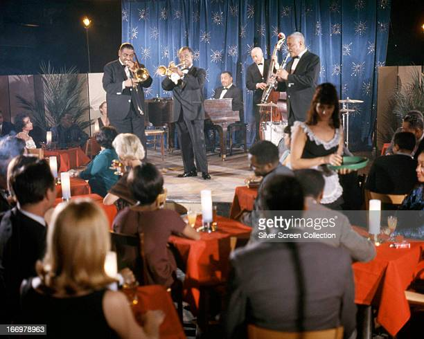 American jazz trumpeter and singer Louis Armstrong performing with Louis Armstrong's AllStars in 'A Man Called Adam' directed by Leo Penn 1966 The...