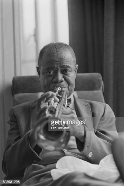 American jazz trumpeter and singer Louis Armstrong playing the trumpet London 27th October 1970
