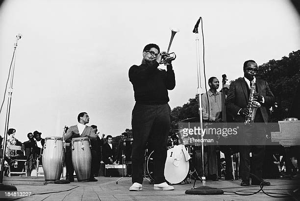 American jazz trumpeter bandleader and composer Dizzy Gillespie and American jazz saxophone and flute player James Moody play for the residents of...