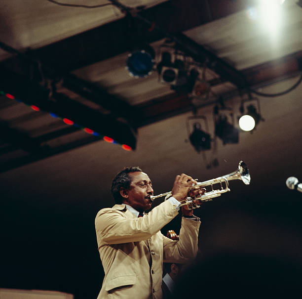 Joe Newman performs on stage at the Newport Jazz Festival...