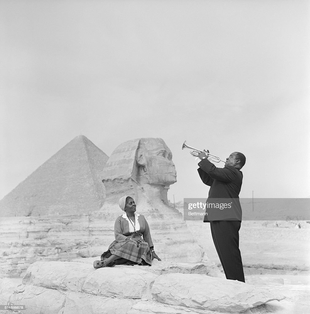 Jazz Trumpeter Louis Armstrong Playing for His Wife in Giza : News Photo